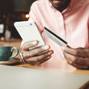 African American Man In Casual Shirt Paying With Credit Card Onl