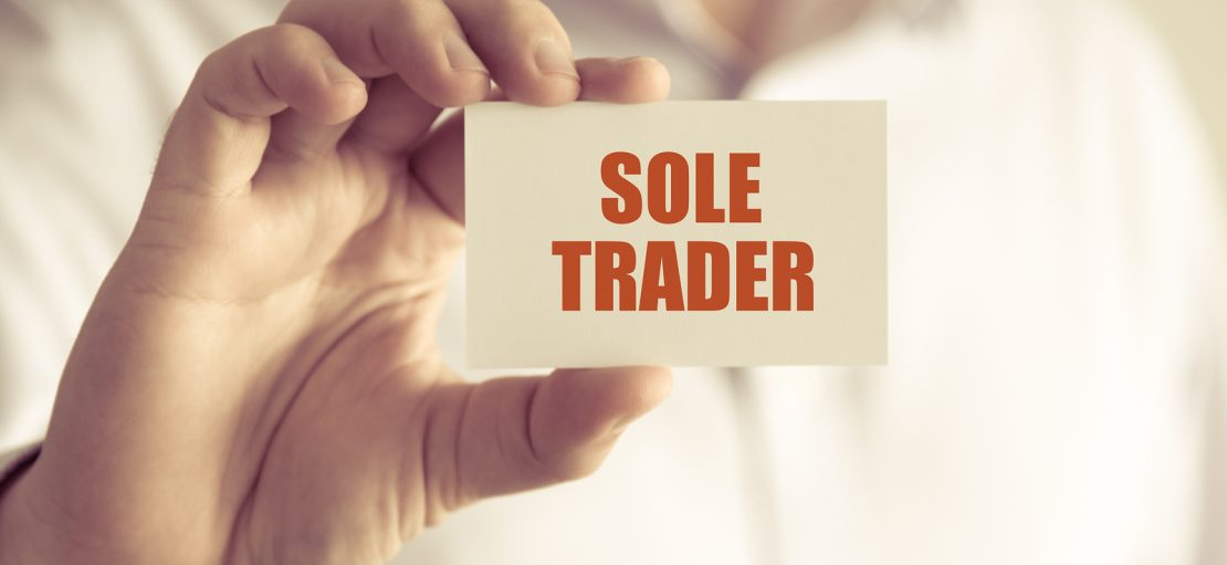 Businessman Holding Sole Trader Message Card