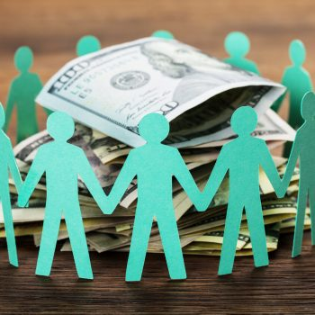 Crowdfunding Concept. Paper Cut Out Human Figures Around The Stack Of Hundred Dollar BillsCrash Course to Successful Reward Crowdfunding