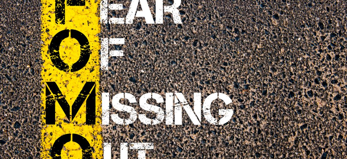 How to Use FOMO to Increase Sales Social Media Acronym FOMO as FEAR OF MISSING OUT. Yellow paint line on the road against asphalt background. Conceptual image