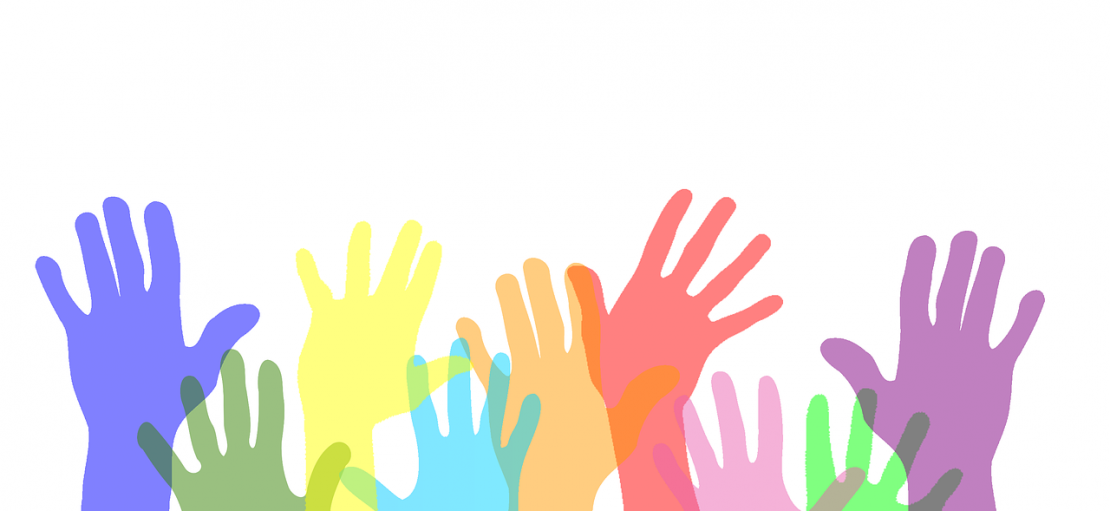 pastel coloured hands held up in air The Growing Power of Giving Back