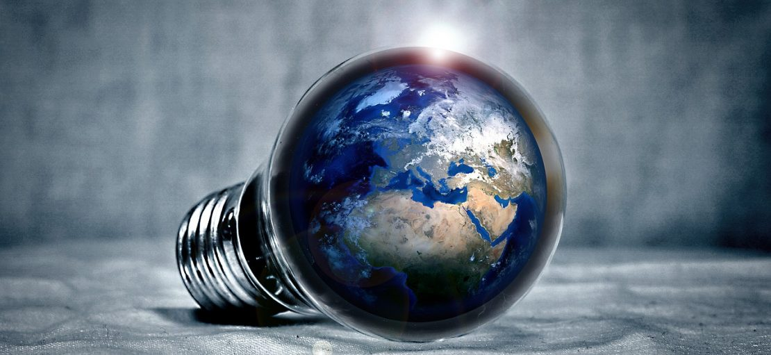 Taking Corporate Responsibility for the Environment earth within energy saving lightbulb